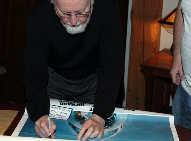 John Williams signs Jaws poster