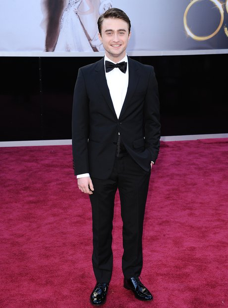 Daniel Radcliffe attends the Oscars 2013 red carpe
