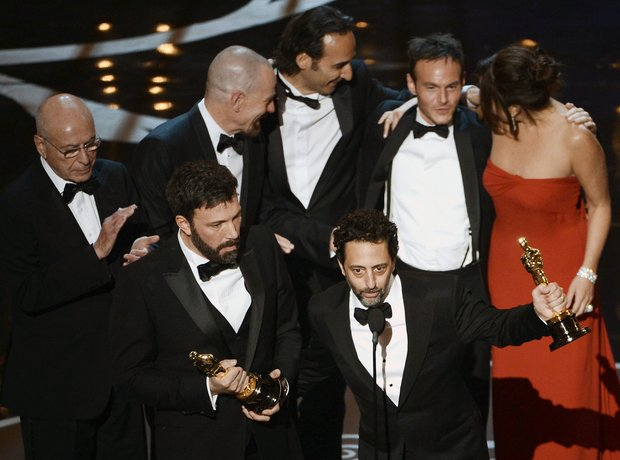 Grant Heslov and Ben Affleck on stage at the Oscar