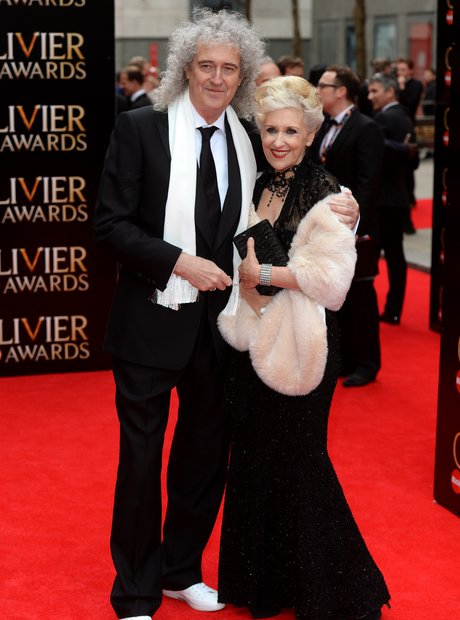 Brian May and Anita Dobson arrive at the Olivier Awards 2013