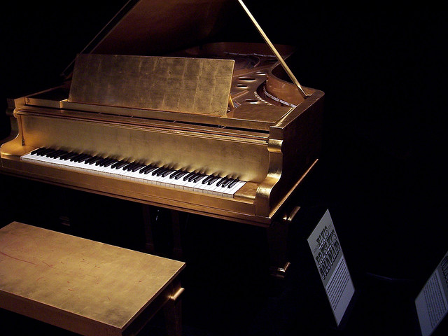 elvis presley gold plated piano