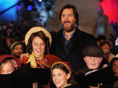 Jim Carrey Christmas Carol.Jim Carrey And Carol Singers A Christmas Carol World