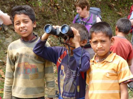 Some local children enjoy playing with Binoculars