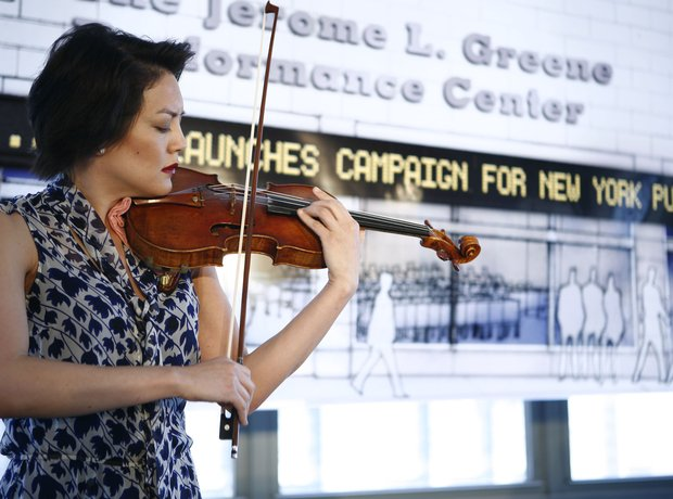 Anne Akiko Meyers playing violin
