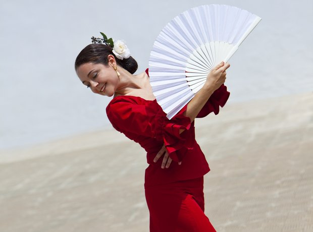 spanish woman red dress fan