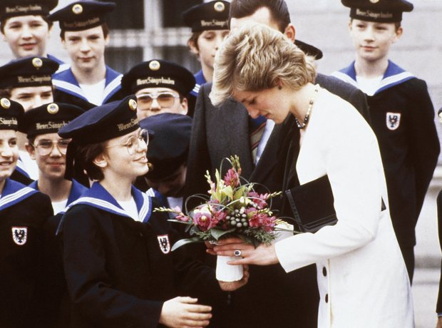 Vienna Boys Choir give flowers to Princess Diana