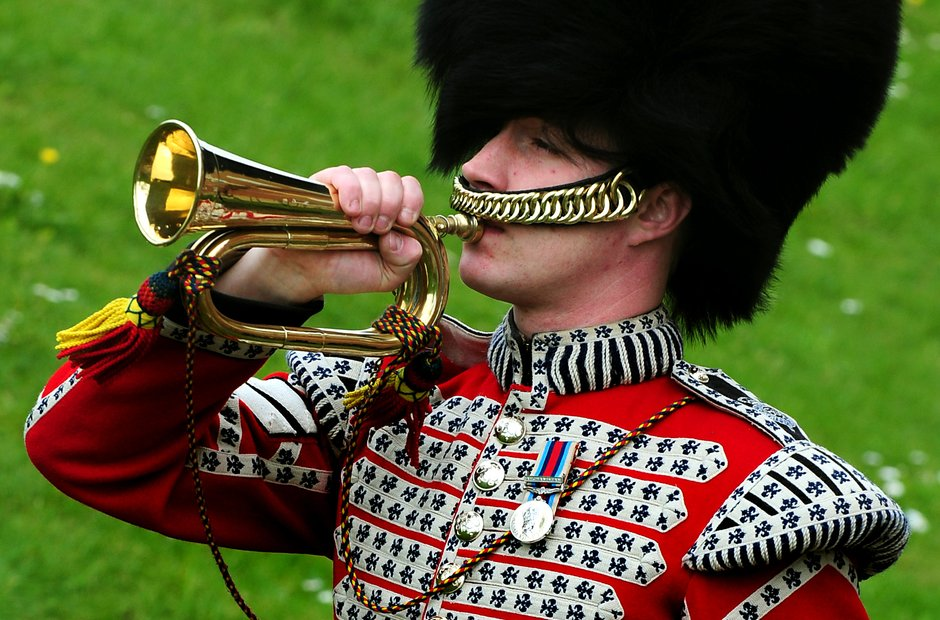 soldier playing last post on bugle