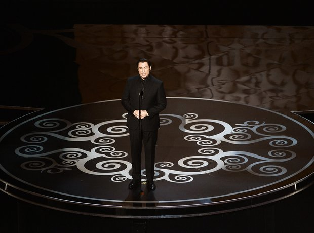 John Travolta presents at the Oscars 2013 awards s