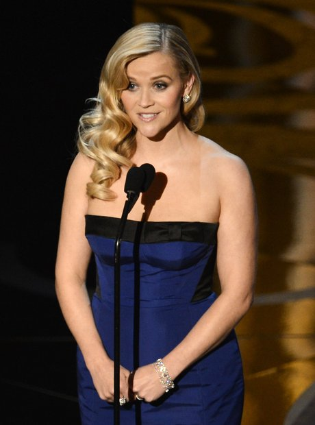 Reese Witherspoon presents onstage during the Osca