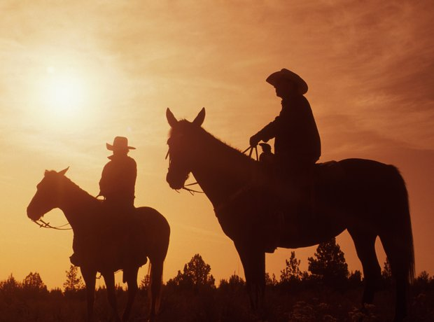 cowboys at sunset