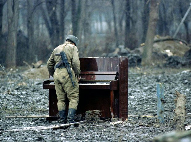 Russian soldier playing Piano 1994