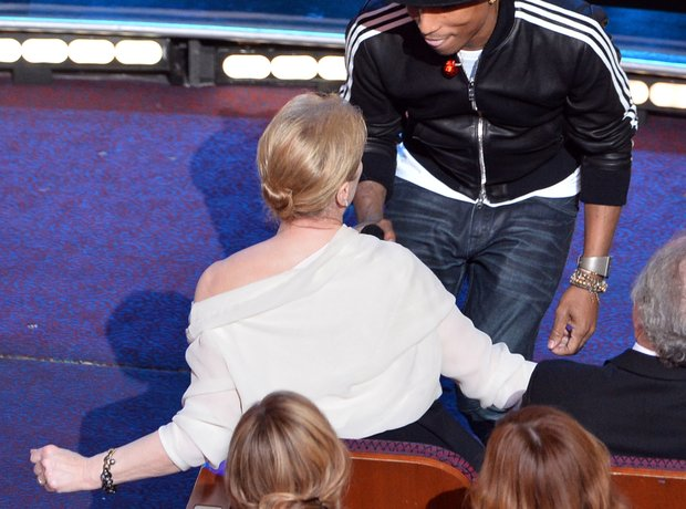 Pharrell Williams performs at the Oscars 2014 with