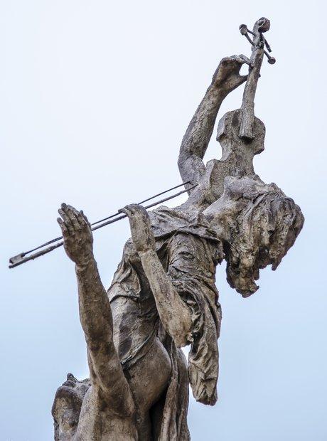 bizarre classical music statues