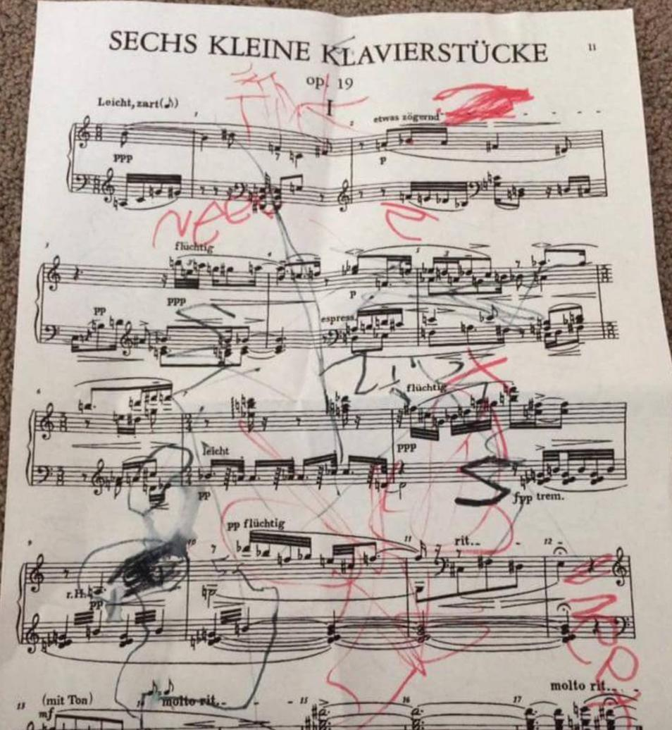 Red pen on sheet music