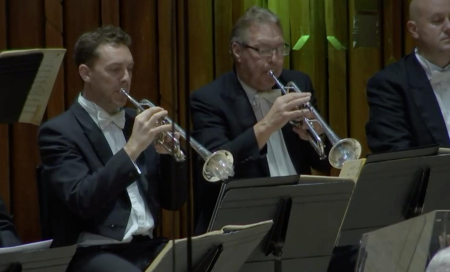 London Symphony Orchestra trumpeters play with pla